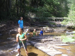 4H Nature Nuts cleaning their adopted stream, Lewis Creek, in Gypsy Hill Park in April