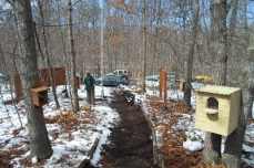Demonstration nest boxes line the entry trail