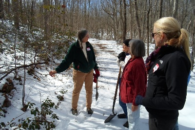 Sandy leading a search for trailing arbutus