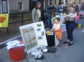 Ann Murray at Staunton's Earth Day with helpful little person wearing Monarch wings.