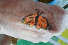 Monarch hand painting by RoxAnna.