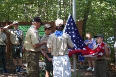 Scouts hoist up the new flag.