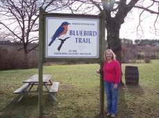Kathy showing some park signage