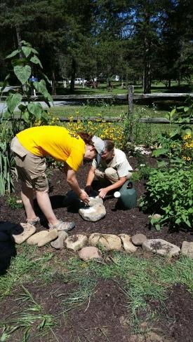 Kelly and Judy making puddling rocks, July 31. Photo by Sandy Greene