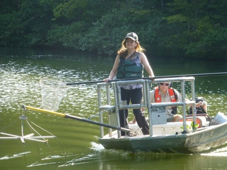 Kate and Paul ply the waters of Holiday Lake to collect fish.