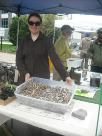 Vermicomposting enthusiast Deva O'Neil demonstrates the value of red wigglers on April 23.