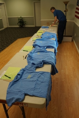 Brian and the t-shirts ready for distribution.