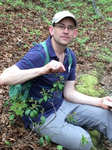 Chip Brown pointing out a prized Large Whorled Pogonia by Ann Murray.