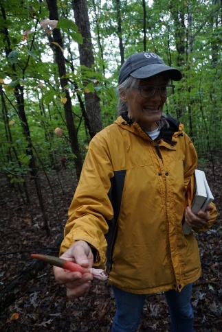 Peggy with an elegant stinkhorn. Photo by Chip Brown.