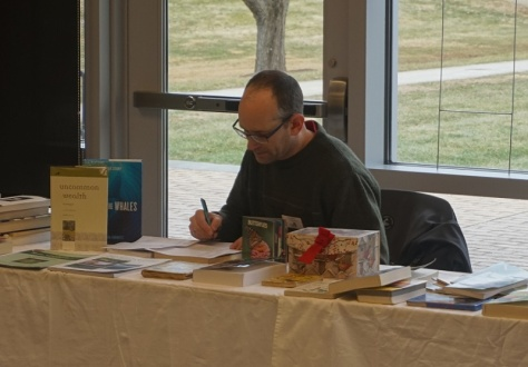 Chip at the book sale table.