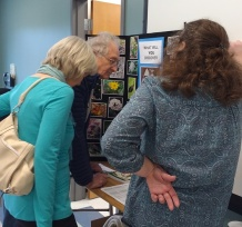 Elaine, Phil and Cheryl checking out a display promoting our adopted Birding & Wildlife Trail sites.