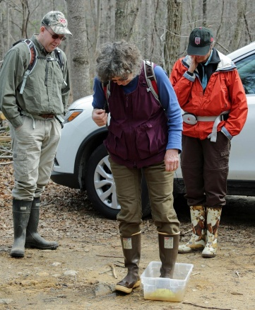 Boot bleaching before entering the ecologically sensitive Maple Flats Ponds area. Photo credit: Debbie Pugh