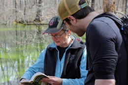 Sue and Ben checking a reference book. Photo credit: Debbie Pugh